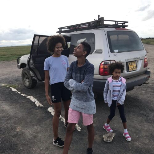 children next to a van