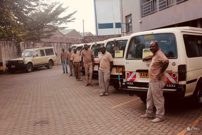 drivers standing behind the vans